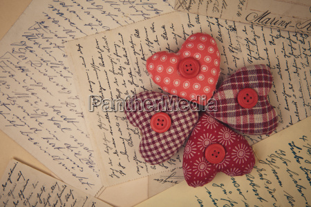 cloth hearts and old handwritten letters
