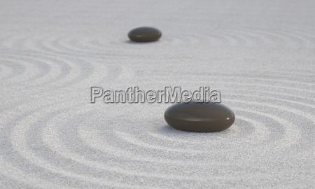 dunkle zen steine auf weissem sand