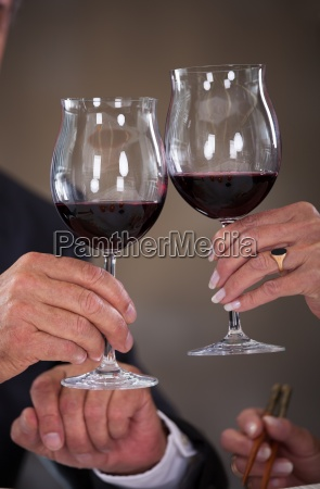 mature couple toasting wine