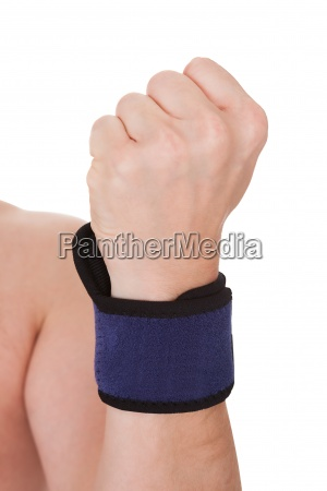close up of man wearing wrist
