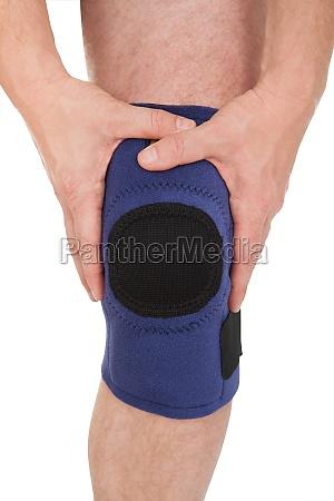 close up of man wearing knee
