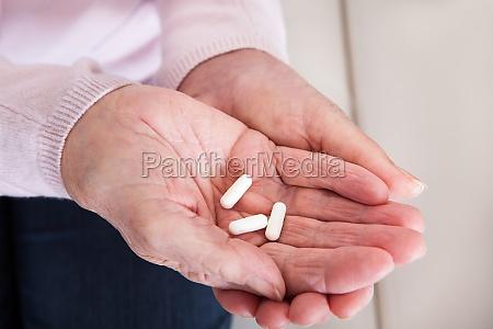 close up of hand holding medicine