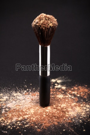 makeup brush and cosmetic powder
