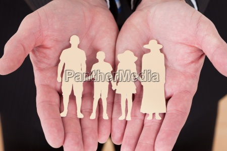 male hand holding family cutout