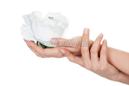 close up of hand holding diamond