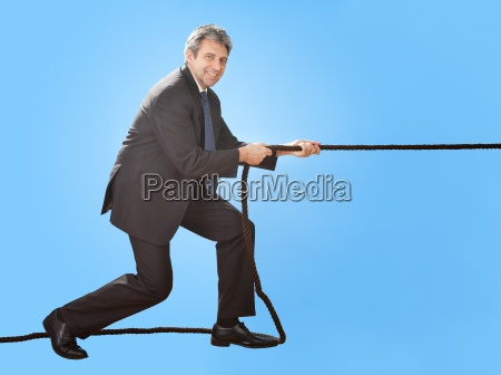 senior businessmen pulling a rope