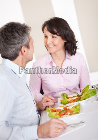 mature couple having lunch at home
