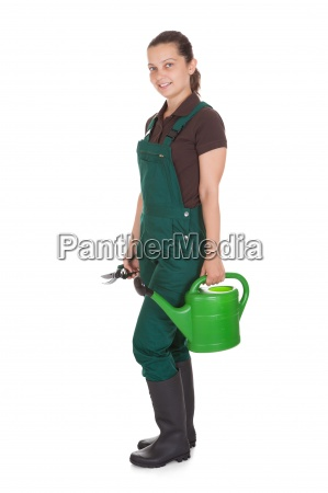 happy woman holding gardening tools