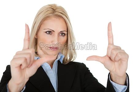 beautiful business woman making a hand