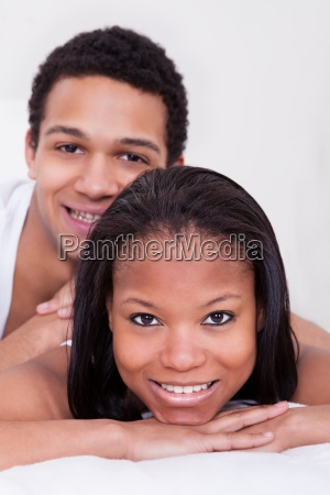 african couple looking at camera