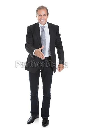 happy business man offering handshake