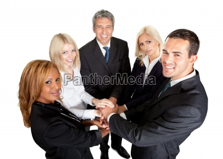 successful businesspeople stacking their hands