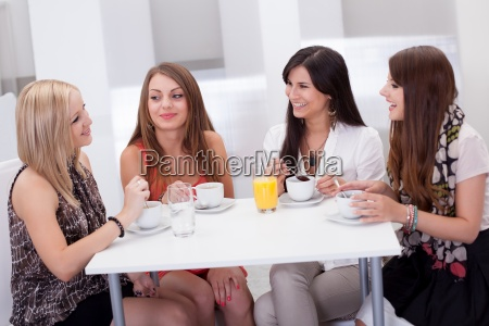 female friends chatting over coffee