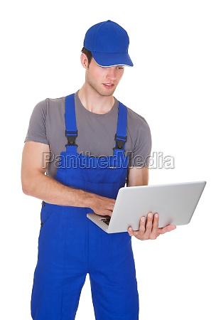 mechanic holding laptop