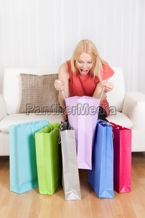 beautiful young woman checking the shopping