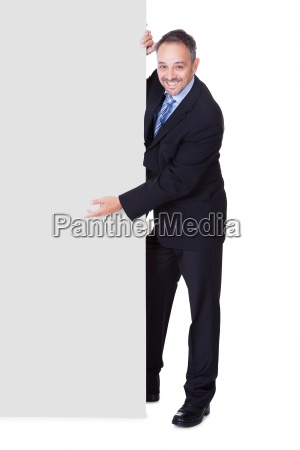happy businessman holding blank billboard
