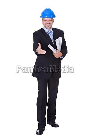happy male architect offering handshake