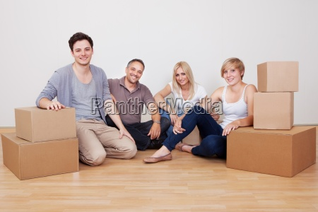 happy family moving into the new