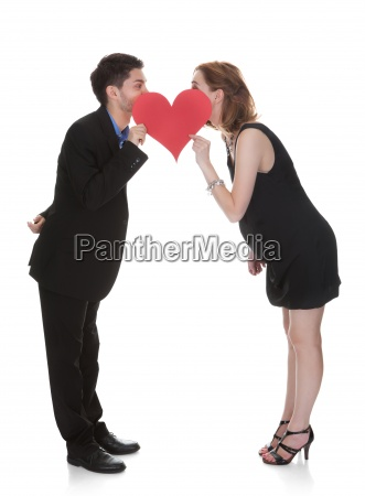 couple holding heart symbol