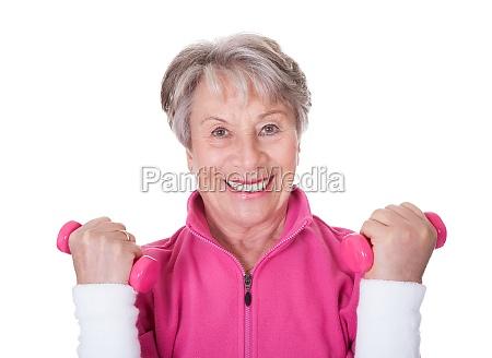 portrait of a senior woman exercising