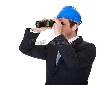 architect looking through binoculars