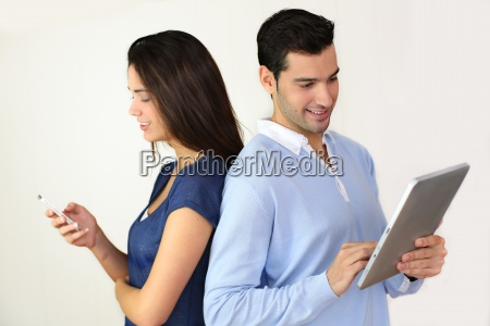 couple websurfing on internet with new