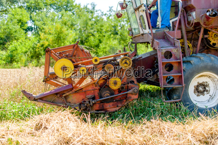 combine harvesting mature wheat crops