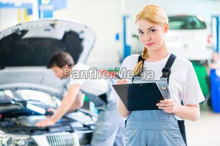 mechanics team working in auto repair