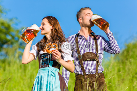 german couple in costume with beer