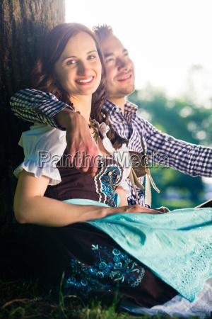 german couple in costume hugging under