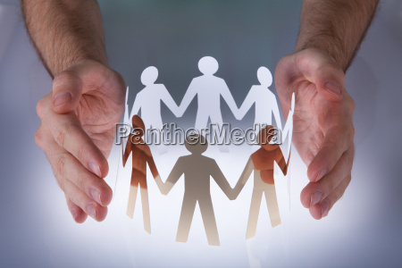 hand with paper people