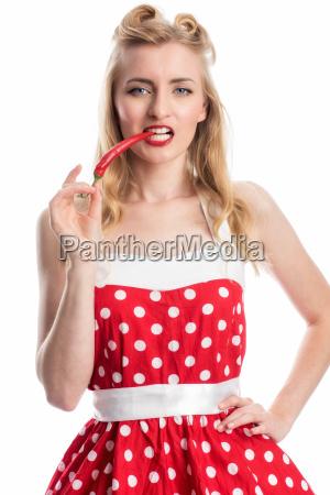 woman biting into a chilli