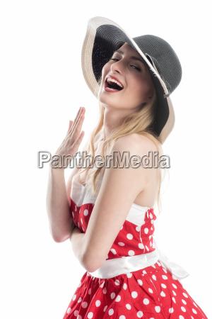 elegant woman with hat flirting