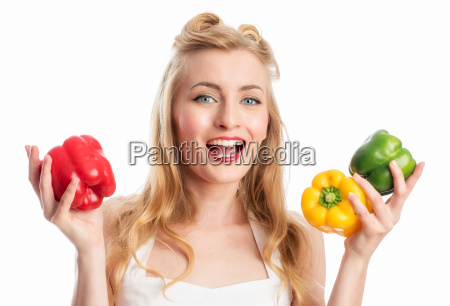 woman holds pepper