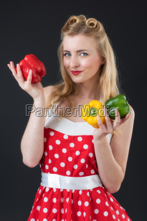 young woman holding peppers