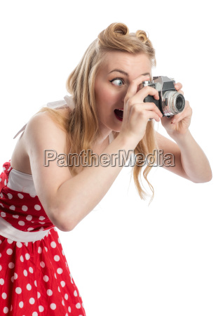 young woman with an old camera