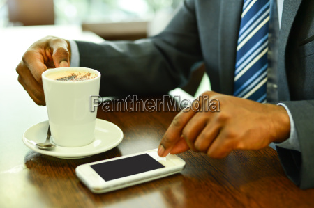 man using mobile phone in the