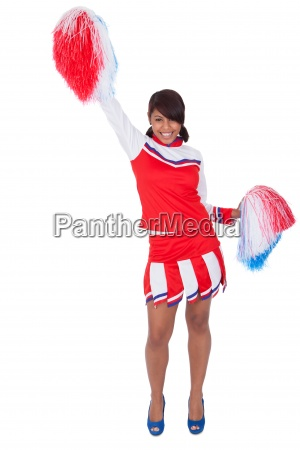 smiling beautiful cheerleader with pompoms