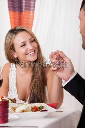 man holding a womans hand at