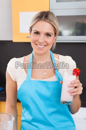 woman with strawberry milkshake