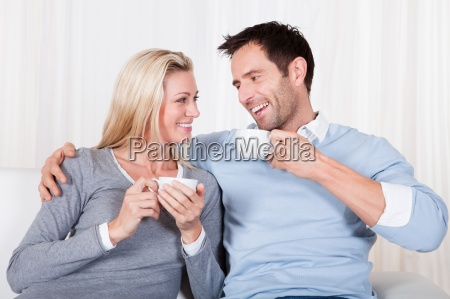 happy couple enjoying a cup of