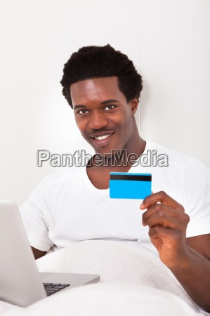 man using laptop for online shopping