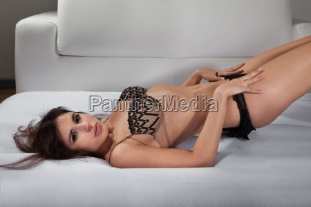 young woman in lingerie lying on