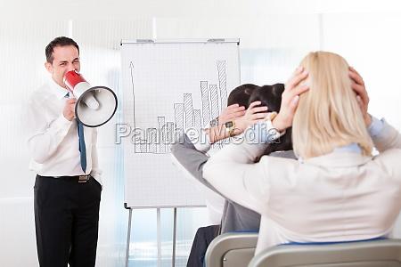 business man shouting in megaphone