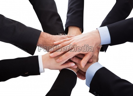 business people stacking hand over each