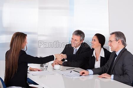 two businesswomen shaking hand