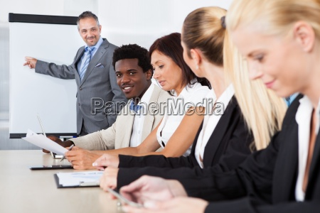 business executives taking notes during a