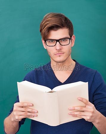 junger student holding book