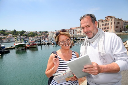 senior couple using digital tablet to