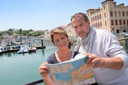senior couple in touristic area looking